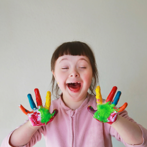 Little girl with paint coloured hands